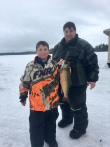ICE FISHERMANFather & Son Making Memories and Breaking Records.